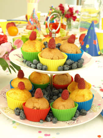 comtemporary: Perfect muffins on colorful laid childrens  table