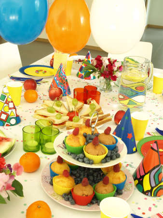 comtemporary: Laid table for perfect birthday party, balloons