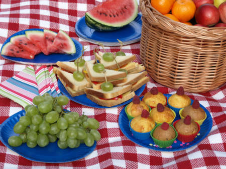 Prepared food for picnic, paper dishes, basket photo