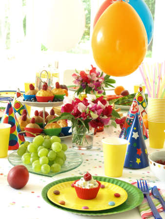 Sweet muffin for toddler, flowers and grapes photo