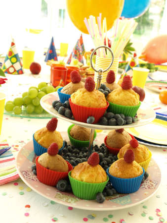 Jummy muffins on laid party table, closeup photo