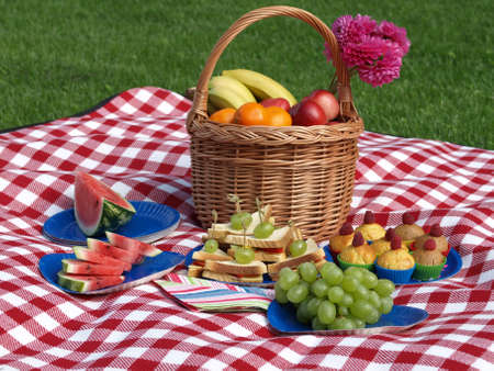 Summer lunch on a grass, basket of fruits photo