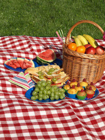 flower baskets: Summer picnic in the morning, colorful napkins Stock Photo