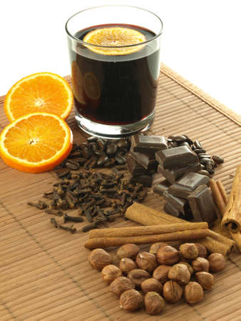 Delicious mulled wine with nuts,orange and chocolate photo