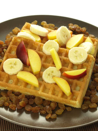 pices: Waffles with pices of fresh bananas and peach