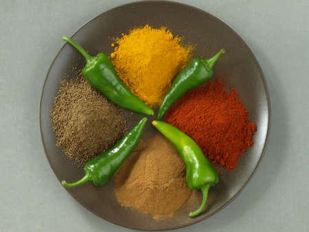 Cumin, pepper, cinnamon and turmeric, bird eye view Stock Photo - 14739701
