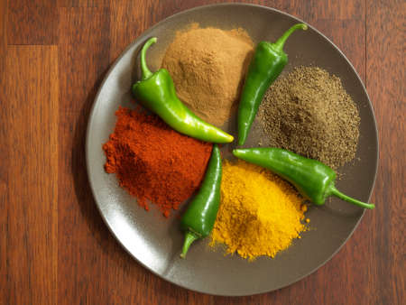 Bird eye view of spices used in hindu cuisine photo