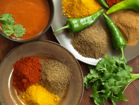 Bird eye view of indian spices and sauce photo
