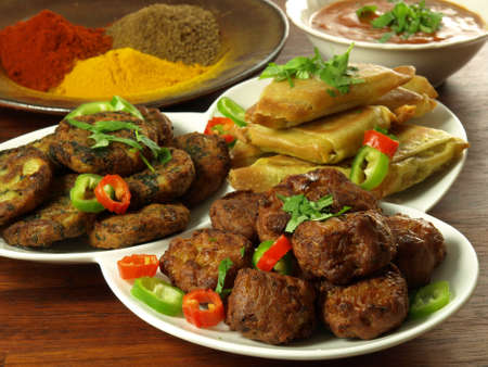 Indian appetizers with bowl of dip and spices photo