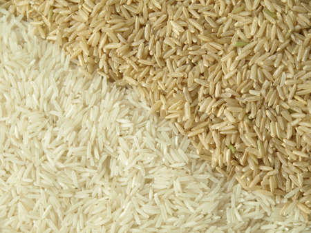 brown rice: Background of natural brown and white rice seeds