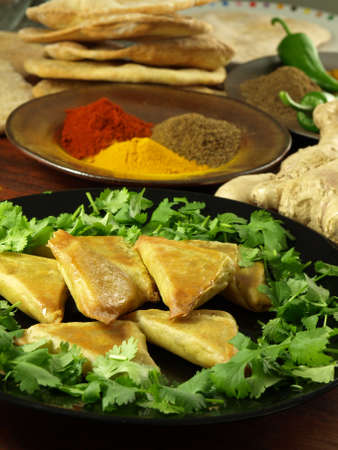 indian meal: Closeup of vegetable samosas with indian hot spices and naan Stock Photo
