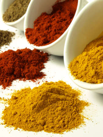 Closeup of spilled indian spices: cumin, turmeric and pepper Stock Photo - 14739688