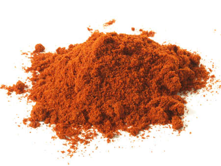 mild: Heap of mild pepper on isolated white background