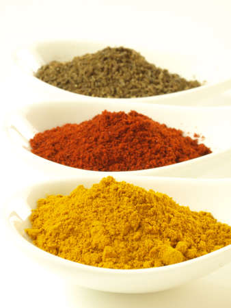 Closeup of indian spices: cumin, turmeric and pepper Stock Photo - 14739800