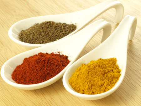 Closeup of ground spices: cumin, turmeric and pepper photo