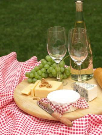 picnic blanket: Closeup of board with different types of cheese