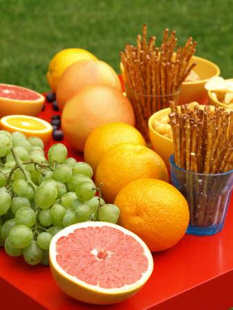 unhealthy snack: Fresh healthy fruits and harmful snacks, closeup