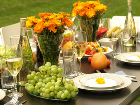 Laid table for anniversary party in garden photo