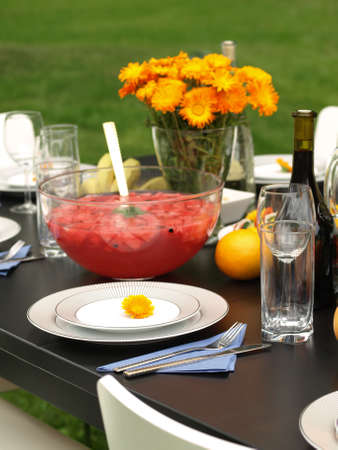 Pink punch on table on garden party photo