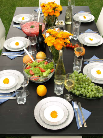 Laid table on green grass in garden photo