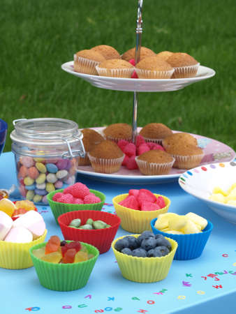 kinder garden: Kinder party in the garden with colorful swets