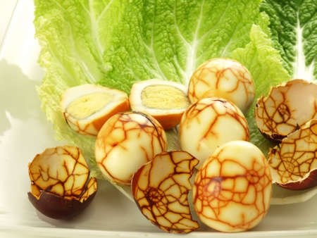 Funny boiled eggs with brown cracked pattern photo