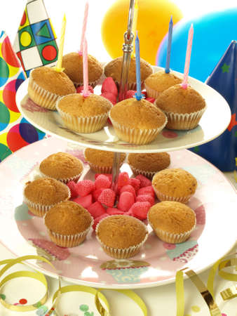 Muffins and jelly beans on the colorful background photo