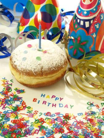 suprise: Birthday suprise: donut, streamer and confetti Stock Photo