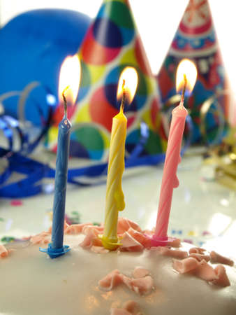 lighted: Third birthday cake with lighted three candles in close up