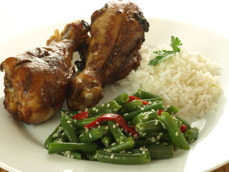 Closeup of chinese dinner: chicken legs and vegetables photo