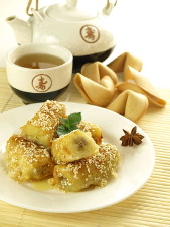fritters: Chinese tea with banana fritters and fortune cookies