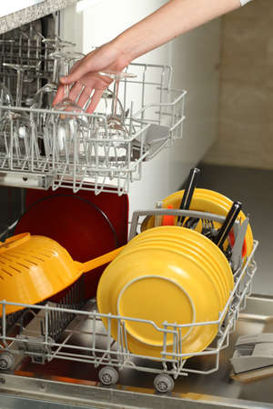Filling the dishwasher in a modern kitchen photo