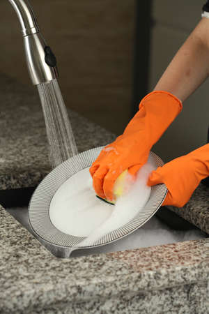 Dishwashing with a special gloves and sponge photo