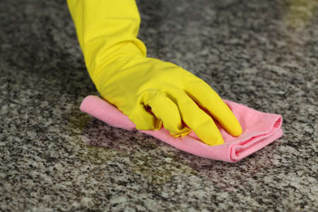 Hand in glove with rubber washing a floor photo