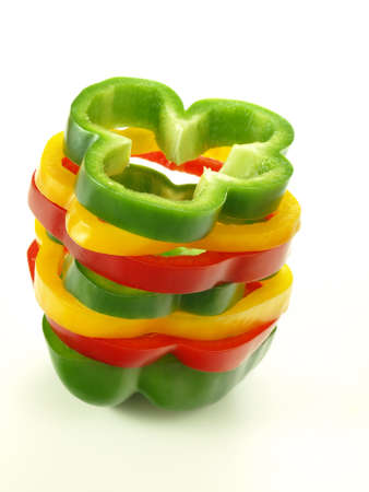bell pepper: Tri-color sliced pepper on isolated white background
