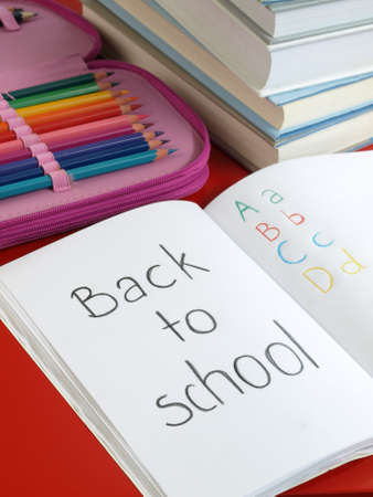 note books: Exercise books, case, colorful crayons and books Stock Photo