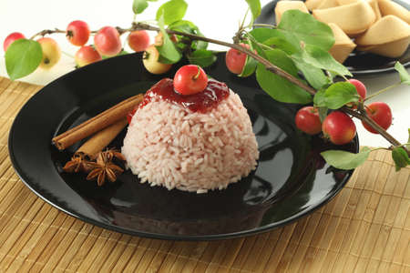 Chinese sweet rice dessert with small apples photo