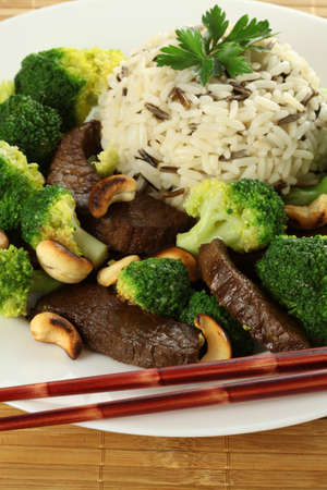 wild rice: Rice, beef meat, broccoli and cashews- chinese meal Stock Photo
