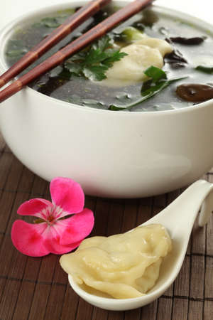 hot breast: Traditional asian soup- wonton with a dumplings
