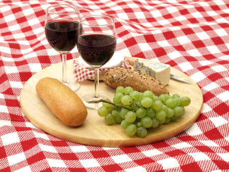 picnic blanket: Two glasses of red wine on a broad