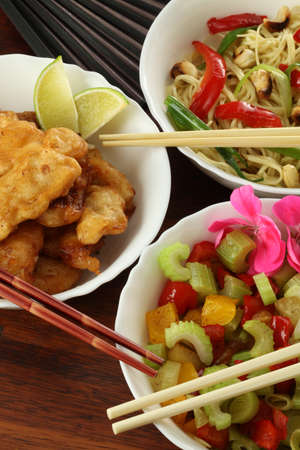 Fillet of fish, salad and chinese noodles  photo