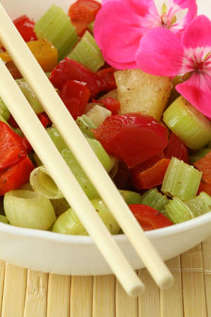 Closeup of salad with colorful oriental vegetables photo