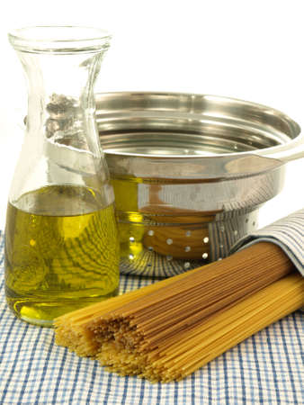 Spaghetti, oil and colander: preparation of dinner Stock Photo - 15526974