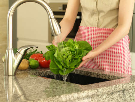 hand washing: Washing lettuce under water- preparing for eating Stock Photo