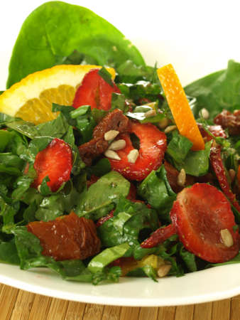 spinach salad: Closeup of spinach and strawberry salad, vertical