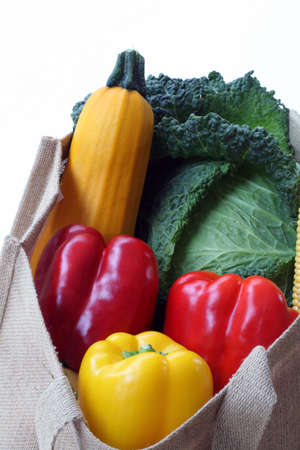 cucurbit: Shopping bag filled with vegetables on white background