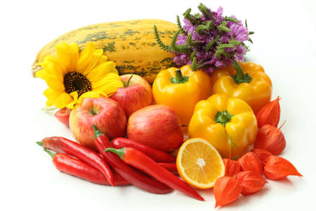 Red apples, chili and yellow peppers and pumpkins, isolated photo