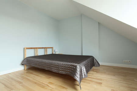 Spacious empty bedroom with wooden huge bed Stock Photo - 15530085
