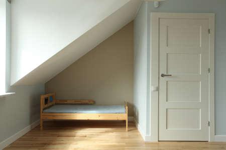 ecru: Blue new children bedroom on the attic, bed Stock Photo