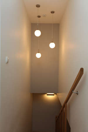 Round lamps in the staircase, modern house photo